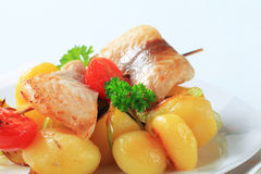 Fish skewer and potatoes Royalty Free Stock Images