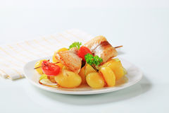 Fish skewer and potatoes Royalty Free Stock Photos