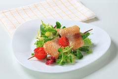 Fish skewer and salad greens Royalty Free Stock Image