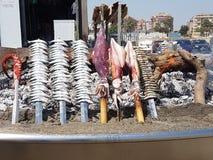 Fish skewers. Skewers of squid sardines octopus Royalty Free Stock Photography