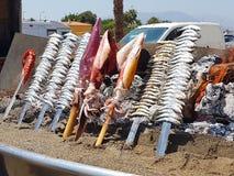 Fish skewers. Skewers of squid sardines octopus Royalty Free Stock Image