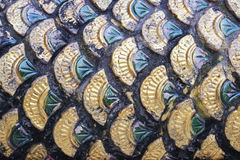 Fish skin ceramics. Ceramics of fish skin in green and gold colors Royalty Free Stock Photo