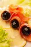 Fish slices with olives Stock Photo