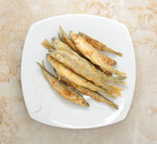 Fish smelt  fried in a plate Royalty Free Stock Images