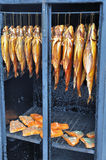 Fish in a smoker stock images