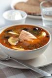 Fish solyanka. Solyanka, Russian soup with salmon, olives and sour cream Royalty Free Stock Photo
