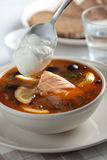 Fish solyanka. Solyanka, Russian soup with salmon, olives and sour cream Stock Images