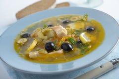 Fish solyanka. Solyanka with salmon and olives closeup Stock Image