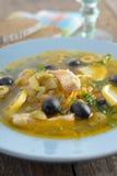 Fish solyanka. Solyanka with salmon and olives closeup Stock Images