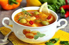 Fish solyanka - traditional russian soup with pickles. Royalty Free Stock Photos