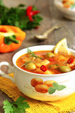 Fish solyanka - traditional russian soup with pickles. Fish solyanka - traditional russian soup with pickles on a wooden table Stock Photos