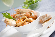 Fish soup. Delicious fish soup with calamari and shrimps Stock Photo