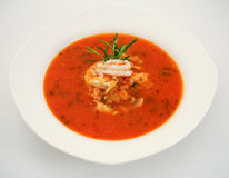 Fish soup. With tomato in white plate Royalty Free Stock Image