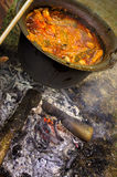 Fish soup. Preparing a fish soup outdoors in a kettle Royalty Free Stock Photos