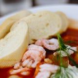 Fish soup with aioli sauce stock photo