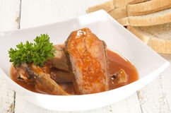 Fish soup in a bowl and bread Stock Images