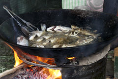 The fish-soup in caldron. The fish market at Awassa lake, Ethiopia. Preparation of the fish-soup in caldron royalty free stock photo