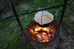 Fish soup cooked over a campfire Royalty Free Stock Photos