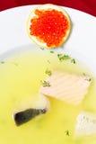 Fish soup with lemon and caviar Stock Photo