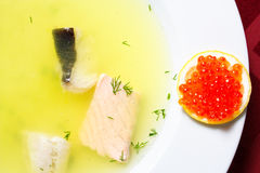Fish soup with lemon and red caviar Royalty Free Stock Photography