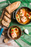 Fish soup made of freshly caught salmon. On old wooden table Stock Images