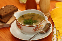 Fish soup. Fish millet, red fish and greens soup Stock Photo