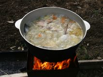 Fish soup on an open fire. Royalty Free Stock Images