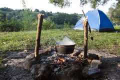 Fish soup preparation on a fire in a cauldron Royalty Free Stock Image