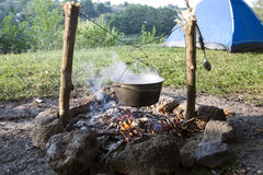 Fish soup preparation on a fire in a cauldron Royalty Free Stock Photography