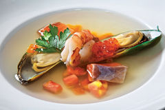 Fish soup with red caviar Stock Photos