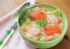 Fish soup with salmon, millet. And potatoes Stock Image