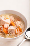 Fish soup with salmon and orge perlé. In bowl Royalty Free Stock Images