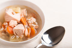 Fish soup with salmon and orge perlé. In bowl Royalty Free Stock Photography