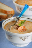 Fish soup with seafood and bread Stock Photo