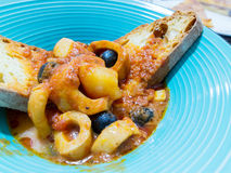 Fish soup. With squid, olive, and tomatoes sauce Stock Photography