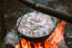 Fish soup to cook on fire in nature. Stock Image