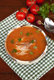 Fish soup with tomato juice. And parsley Stock Image