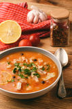 Fish soup with tomatoes and garlic aljotta. Stock Image