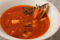 Fish soup with tomatoes and mussels Royalty Free Stock Photo