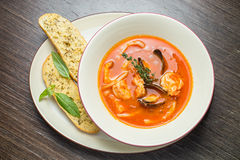 Fish soup with tomatoes and mussels Stock Images