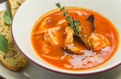 Fish soup with tomatoes and mussels Royalty Free Stock Photography