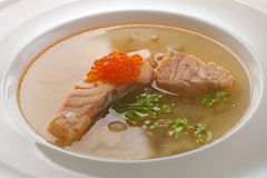 Fish soup. Traditional Russian fish soup with salmon, pike-perch, caviar and parsley Royalty Free Stock Photography