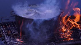 Fish soup `uha` on the fire stock footage