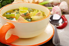 Fish soup with vegetables in a bowl. Fish soup with vegetables, celery in a cup for the broth Royalty Free Stock Photography