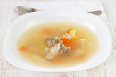 Fish soup in white plate Royalty Free Stock Photo