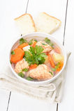 Fish soup on white wooden table Royalty Free Stock Photography