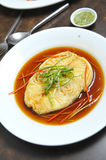 Fish in soy sauce Royalty Free Stock Photo