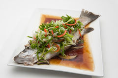 Fish in soy sauce Royalty Free Stock Photos