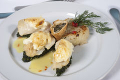 Fish and spinach a la carte meal. Main meal of fish and spinach a la carte in a restaurant royalty free stock images
