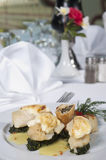 Fish and spinach a la carte meal. Main meal of fish and spinach a la carte in a restaurant stock images